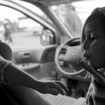 Inside their mother's car Eavan Kuenle blows a kiss to her sister Ella.